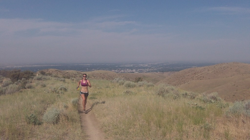 Sandi runs up above town on the foothills trail system