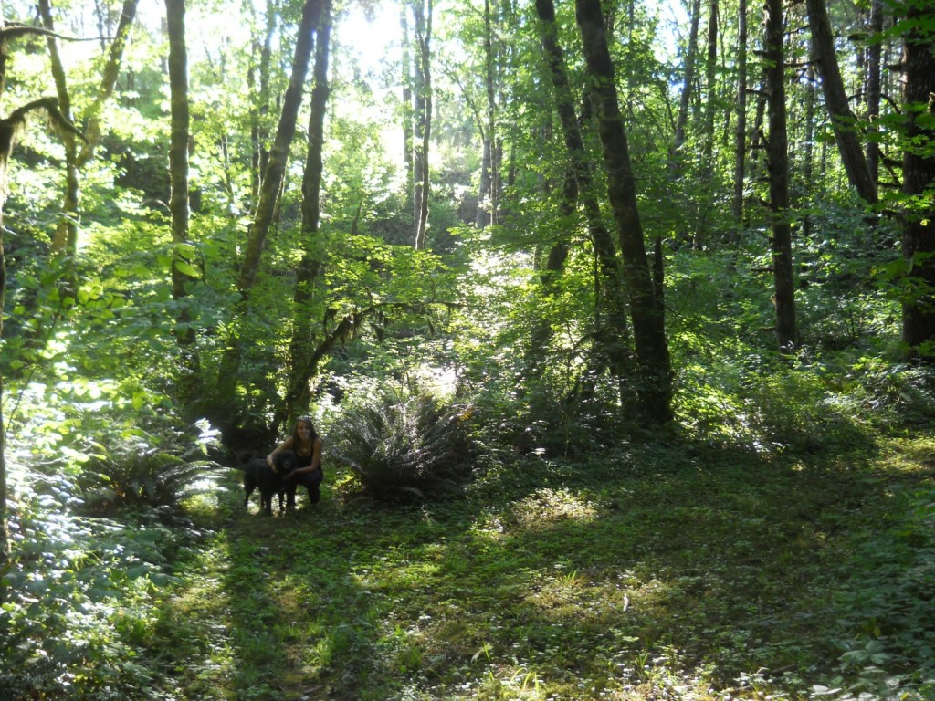 Where I grew up running trails..in the woods of Oregon. Sandi with my dog.