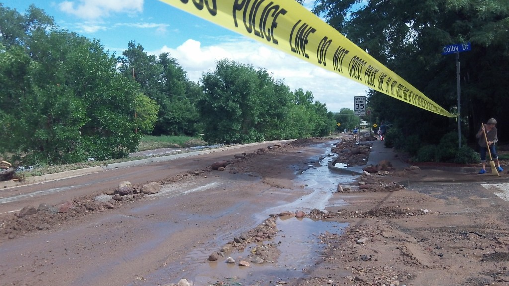 Water from Bear Canyon rushed down Table Mesa road, carrying large rocks